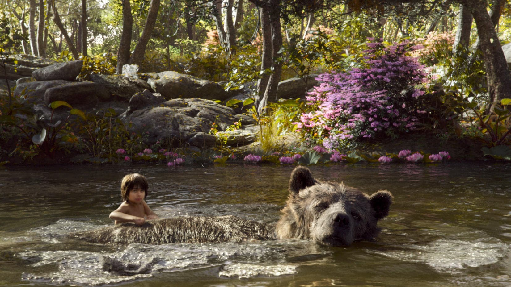 Mowgli and Baloo in The Jungle Book