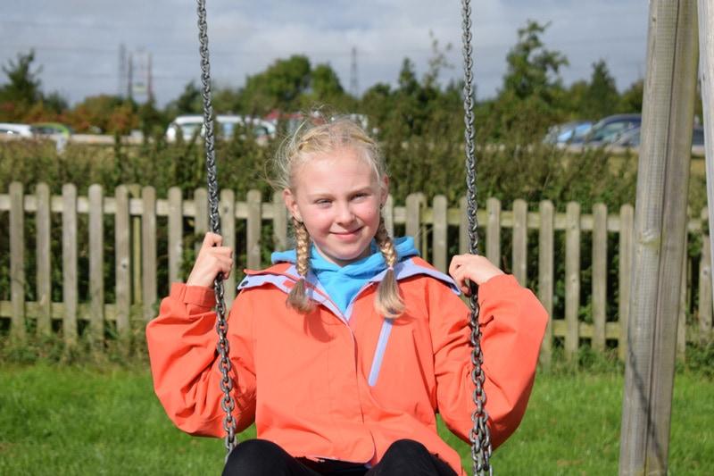 Imogen on the swings